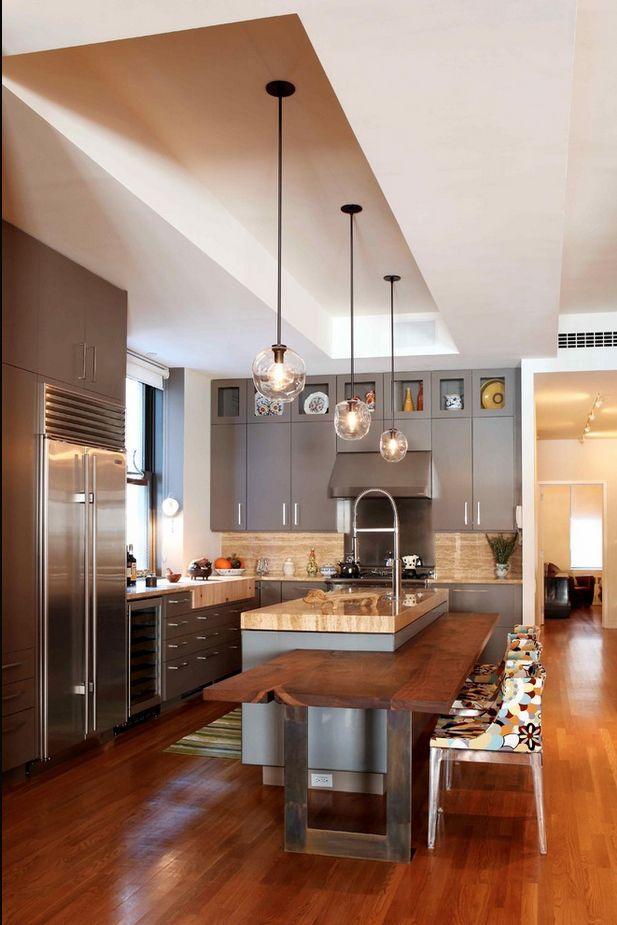 cocina con mrmol en pared y encimera muy moderna y verstil